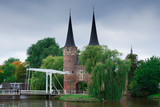 city gate with towers, lifting bridge and water in Delft, The Netherlands