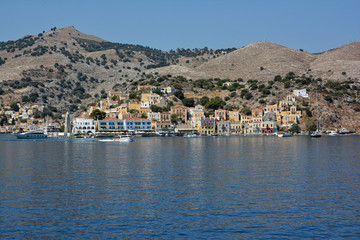 View of beautiful bay with colorful houses on the hillside of the island of Symi. Greece