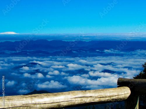 Clouds covering brazilian mountains, a beautiful horizon - 259959056