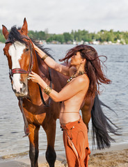 horse and young beautiful naked Amazon woman on river beach