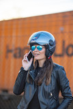 pretty woman with helmet motorcycle talking mobile phone