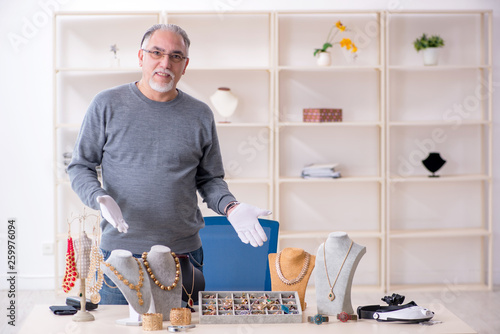 White bearded old jeweler at workshop  © Elnur