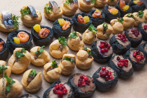 Tasty and juicy snacks for buffet table: mini burgers, canapés, fruit, sliced and baked © Антон Фрунзе