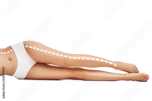 My ideal legs. Cropped photo of beautiful and slim female legs with white dotted line. Isolated on white background. Healthcare and Beauty concept © dima_sidelnikov
