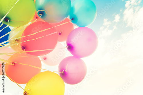 fototapeta na ścianę Colorful balloons done with a retro instagram filter effect. Concept of happy birth day in summer and wedding, honeymoon party use for background. Vintage color tone style