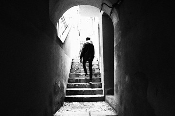 Traveler climbing the stairs in an alley © Jordan