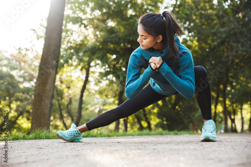 Beautiful young fitness woman doing morning exercising