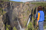 Tourist woman by Voringsfossen waterfall, Norway