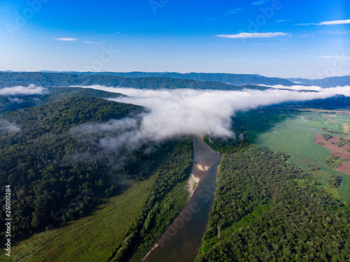 aerial view landscape of mountains with river and clouds - 260110284