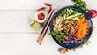 Leinwandbild Motiv Top view composition of vietnamese food in bowl