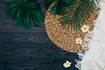 tropical leaves on wooden background