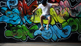 Skater is jumping on skate on ghetto background graffiti