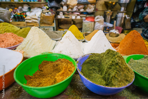 Colorful spices powders and herbs in traditional asian street shop © Irina84