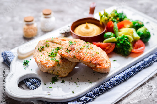 Fried chicken breast with mustard sauce and fresh vegetables. - 260197230