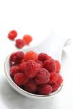 Red raspberry on white background. Ripe fresh raspberry - vegetarian natural product. Lean food.
