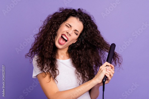 Leinwandbild Motiv Close-up portrait of nice cute lovely attractive crazy wavy-haired lady using new electric product hot temperature care device ironer isolated on bright vivid shine violet pastel background