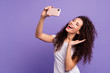 Leinwandbild Motiv Portrait of her she nice attractive winsome lovely cheerful cheery funny girlish wavy-haired lady making taking selfie good day isolated on bright vivid shine violet pastel background