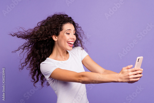 Leinwandbild Motiv Portrait of nice cute attractive sweet winsome lovely cheerful wavy-haired lady making taking selfie good day isolated on bright vivid shine violet pastel background