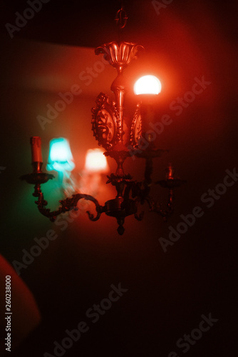 wall crystal sconces with pendants. red and blue lighting. similar to the effect of 3d. great decor for a pub or cafe. selective focus - 260238000