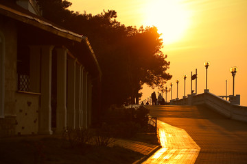 people walk on the promenade in the evening at sunset © Anna81