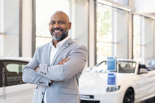 Happy salesman in car showroom © Rido