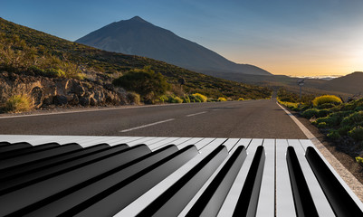 piano keyboard painted on an asphalt road.