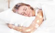 Young woman  sleeping on the white linen in bed at home