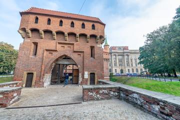 KRAKOW, POLAND - SEPTEMBER 30, 2017: Barbakan Krakovski with tourists. Cracow is a major city of Poland
