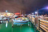 SAN FRANCISCO, CA - AUGUST 6, 2017: Night view of Fisherman's Wharf port. The city attracts 20 million tourists annually - 260314225