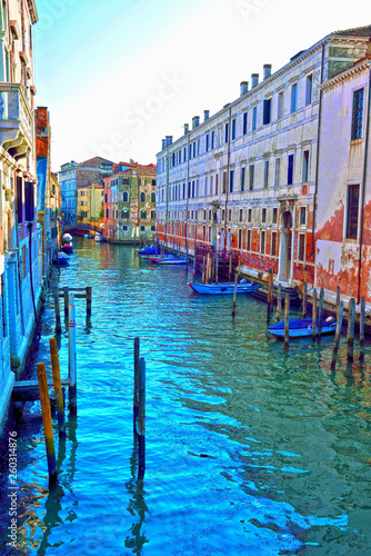 a canal of the lagoon and historic buildings Venice Italy