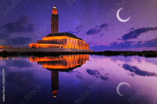 view of Hassan II mosque reflected on water at night - Casablanca - Morocco © Morocko
