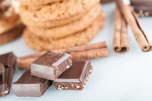 Various shortbread, oat cookies, chocolate chip biscuit and pieces of chocolate with seeds and nuts. © Ded Pixto
