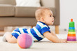 babyhood, childhood and people concept - sweet little asian baby boy playing with toy ball