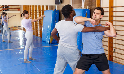 Two men practicing self defense techniques