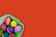 Quadro Basket with Easter eggs on a red background