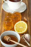 tea, lemon, honey and garlic on a wooden counter, healthy and natural remedies for colds