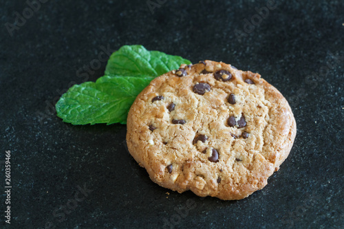 Cookie with chocolate chips and two mint leaves © oceane2508