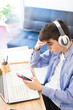 young teenager listening to music with headphones