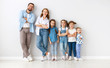 Leinwanddruck Bild - large family mother father and children sons and daughters on white background