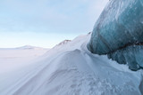 Glacier ice on Svalbard surrounded by snow
