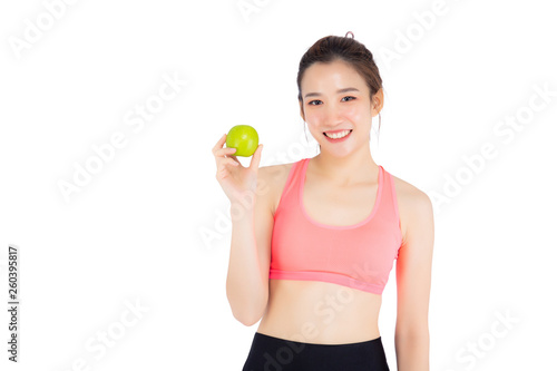 canvas print picture Beautiful portrait young asian woman in sport clothing with satisfied and holding green apple isolated on white background, girl asia have shape and wellness, exercise for fit with health concept.