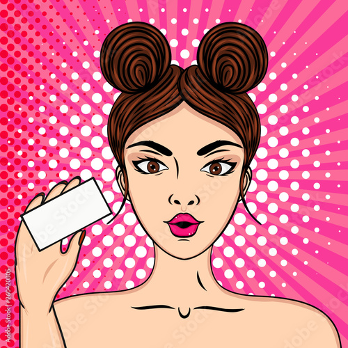 Sexy fashion girl holds a business card in her hand, wow effect. Pop art colourful vector illustration. Place for your advert, business card or text. © reddish