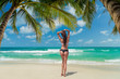Leinwanddruck Bild - Woman enjoying her holidays on the tropical beach i