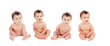 Four equal babies sitting on the floor
