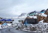 Acrtic road to the docks and port between the rocks with Inuit houses, Sisimiut, Greenland