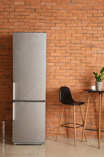 Leinwandbild Motiv Modern fridge, table and chair in kitchen