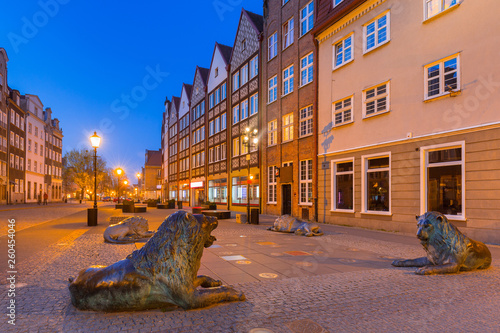 Architecture of the old town of Gdansk with bronze lions statues - emblem of the city, Poland