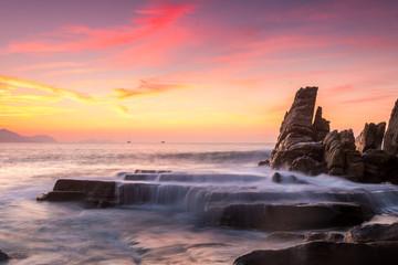 beautiful sunset at rocky beach
