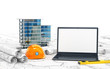 Planning of the house, drawing projects, a helmet and an open laptop with a blank screen. 3d illustration