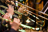 Trumpets in the hands of musicians in the orchestra